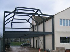 Steel frame supporting external wall, roof and floor